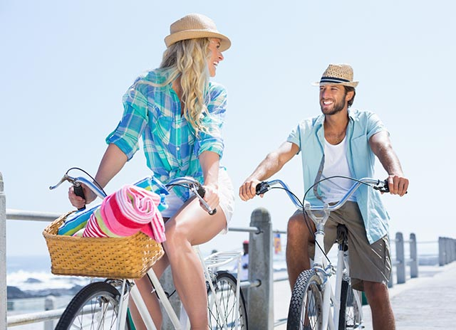 Couple biking near beach